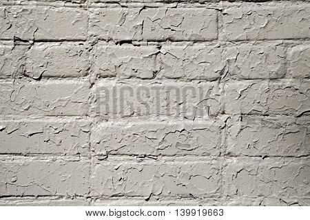 Cracked gray paint on a brick wall. Grunge textured background