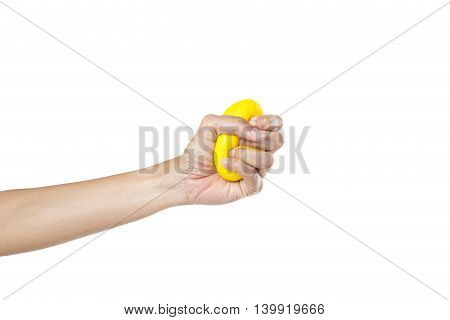 Hands of a woman squeezing a stress ball on white background