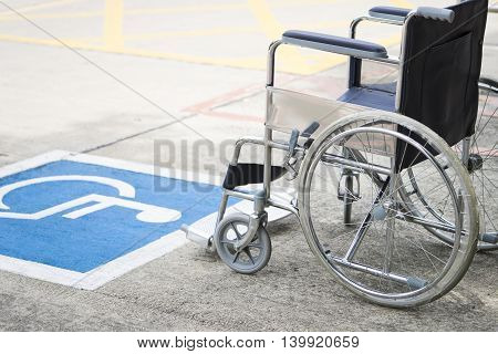 close up of pavement handicap symbol and wheelchair