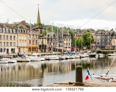 The moored yachts and medieval houses in Old Harbor. Honfleur, Normandy, France