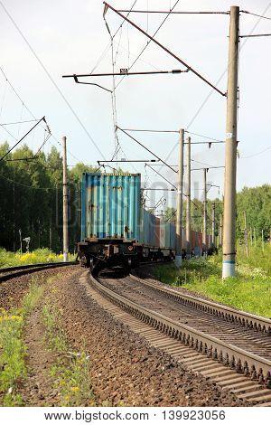 Train Freight transportation. Cargo transit. Summer Day