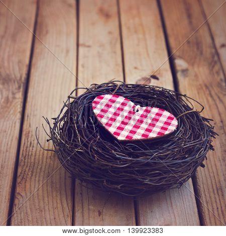Valentine's day background. Heart shape in bird nest