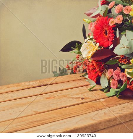 Retro backgrouns with flowers and wooden table
