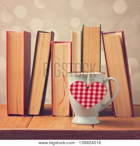 Valentine's day cup with heart shape and books