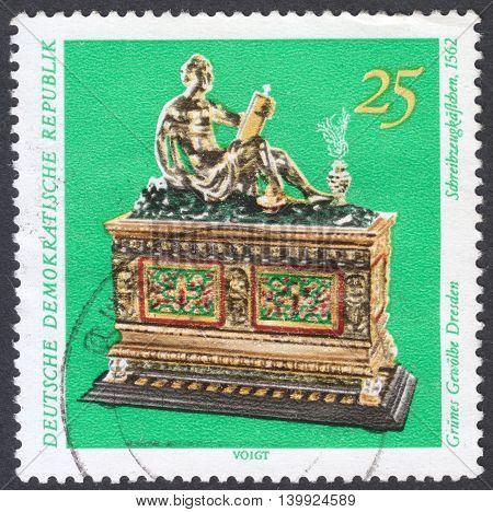MOSCOW RUSSIA - CIRCA FEBRUARY 2016: a post stamp printed in DDR shows a writing Prox the series