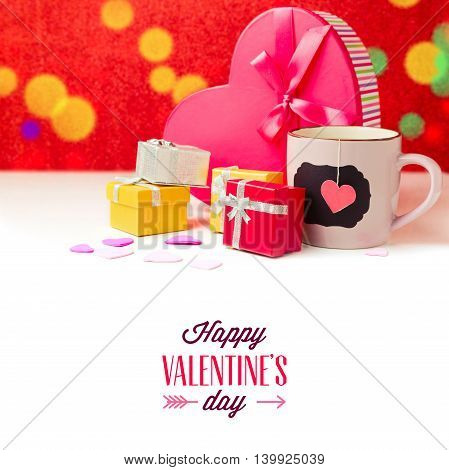 Gift boxes and cup of tea for Valentine's day on white