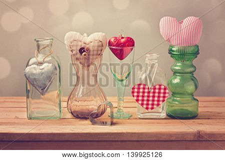 Valentine's day background with heart shapes in different vases