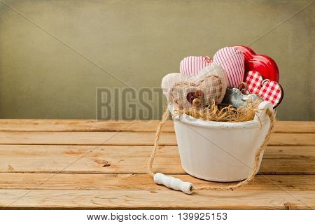 Valentine's day background with heart shapes in wooden bucket