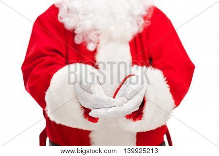 Close-up of Santa Claus offering something isolated on white background