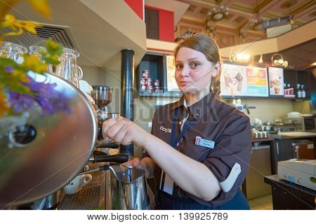 MOSCOW, RUSSIA - JUNE 26, 2016: barista in Costa Coffee. Costa Coffee is a British multinational coffeehouse company. It is the second largest coffeehouse chain in the world behind Starbucks.