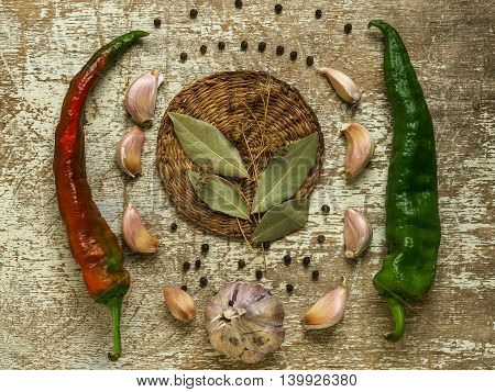 A set of spices and herbs on wicker board
