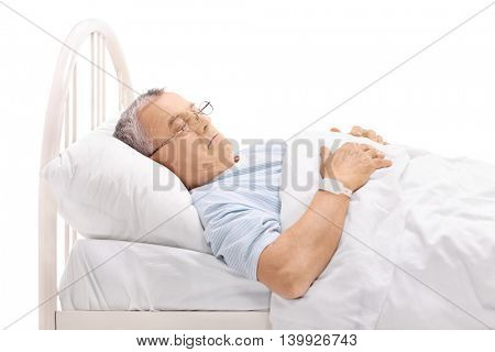 Pensive mature patient laying on a hospital bed isolated on white background