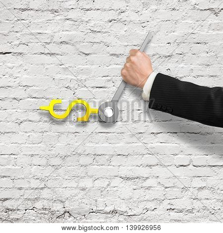 Hand Holding Clock Hands With Money Sign On White Bricks Wall