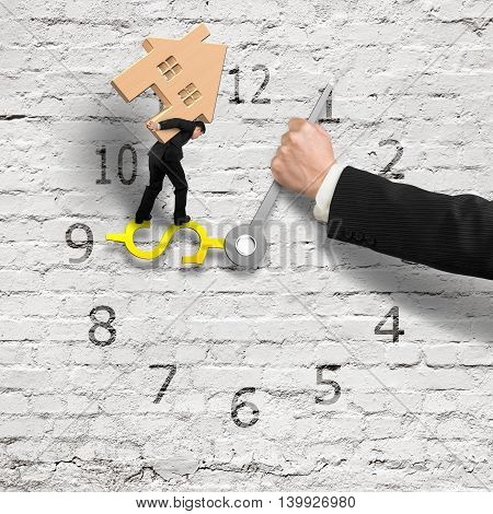 Businessman Carrying House Balance On Money Sign Clock