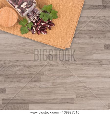 Beans and parsley leaves on the old wooden table