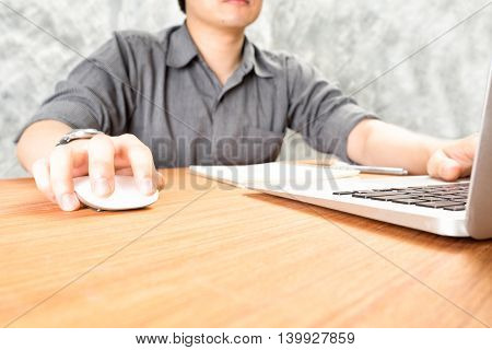 businessman working with laptop computer in office Business concept soft focus vintage tone