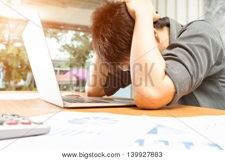 Depressed businessman in office Business concept soft focus vintage tone