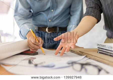 business architect drawing on blueprint architectural concept soft focus