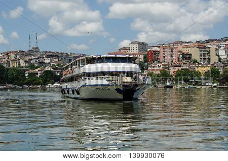 ISTANBUL TURKEY - JUNE 5 2016: The passenger ferry Polaris sailing into the Ayvansaray stop on the Golden Horn in Istanbul on a sunny afternoon in June.