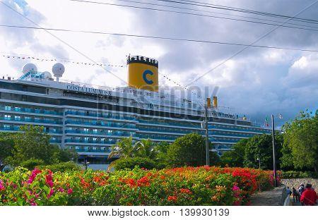 La Romana, Dominican Republic - February 04, 2013: Costa Luminosa cruise ship, owned and operated by Costa Crociere, built by Fincantieri Marghera shipyard in 2009.