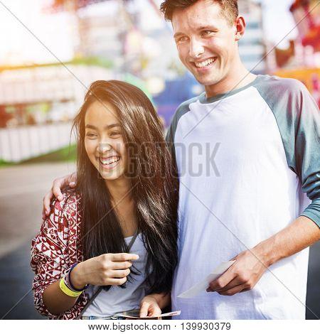 Teenage Couple Amusement Park Concept