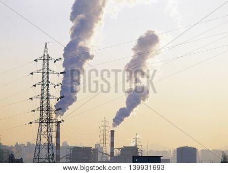 The sky glow and smoke chimney