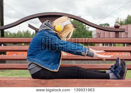 Girl Listening To Music Streaming With Headphones.