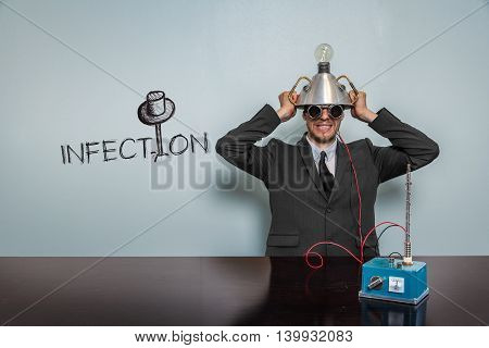 Infection text with vintage businessman and machine at office