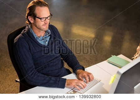 High angle view of creative businessman working on computer in office