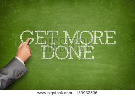 Business text on blackboard with businessman hand pointing
