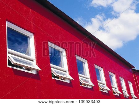 Red building with open windows