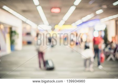 Blurred Background : Traveler With Baggage At Airport Terminal Blur Background With Bokeh Light