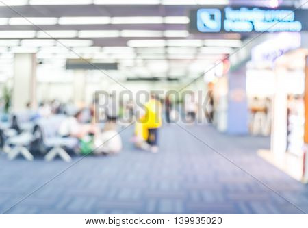 Blur Background : Passenger Waiting For Flight At Airport Terminal Blur Background With Bokeh Light