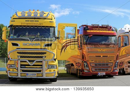 HAMEENLINNA, FINLAND - JULY 16, 2016: Front view of new colorful customized Scania and Volvo heavy trucks displayed on the annual Tawastia Truck Weekend 2016, public event.