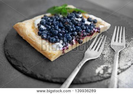 Fresh berry dessert on a slate plate