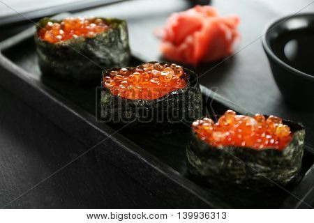 Sushi roll set in wooden plate, close up