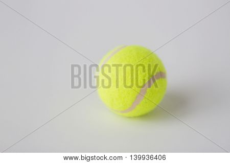 sport, fitness, game, sports equipment and objects concept - close up of tennis ball