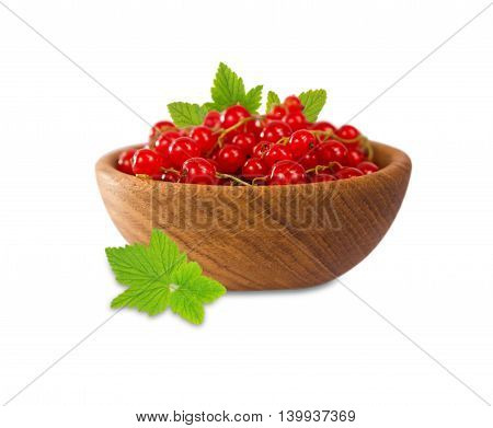 Redcurrant in a wooden bowl isolated on white background.