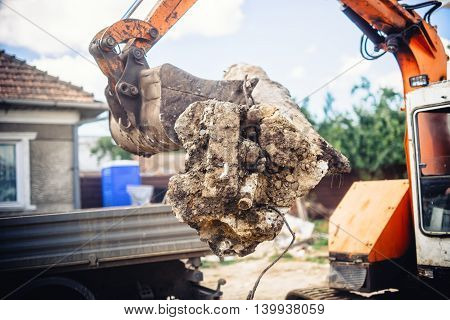 Hydraulic Backhoe Bulldozer Loading Demolition Debris, Stone And Concrete For Recycling