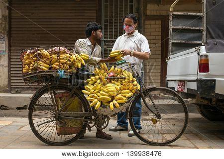 Kathmandu, Nepal - May 21, 2016: Unidentified banana seller on the streets of Kathmandu, Nepal.