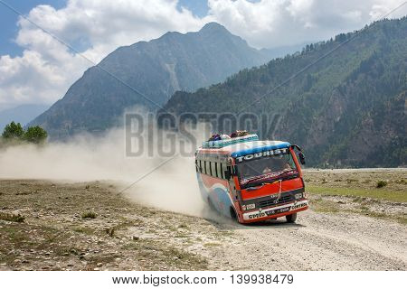 Dana, Nepal - May 15, 2016: Local nepalese bus driving crazy in the countryside of Himalayan region of Nepal.