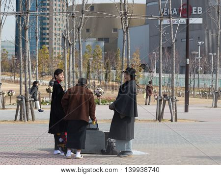 Tokyo - 7 February 2015: Unusually happy people dressed in the pedestrian area of Odaiba in good weather 7 February Tokyo Japan