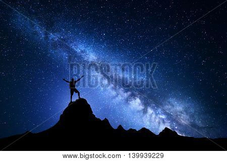 Landscape With Milky Way And Silhouette Of A Happy Climber