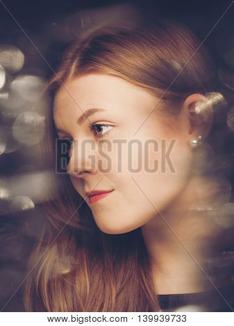 Glamorous retro film style beauty portrait with faded bokeh effects