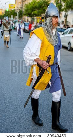 Modugno Italy - June 23 2016: parade with costumes of the Middle Ages. Featured soldier with helmet in metal and armed with sword