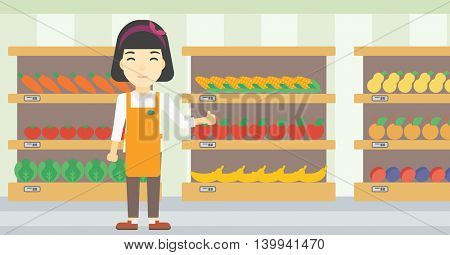 An asian young female supermarket worker showing thumb up on the background of shelves with vegetables and fruits in supermarket. Vector flat design illustration. Horizontal layout.