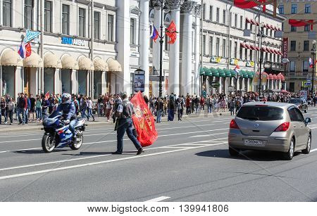 St. Petersburg, Russia - 9 May, Man with a flag of the rolling road, 9 May, 2016. Celebration day of victory in the center of St. Petersburg.
