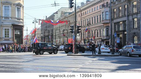 St. Petersburg, Russia - 9 May, SUVs with festive flags, 9 May, 2016. Celebration day of victory in the center of St. Petersburg.