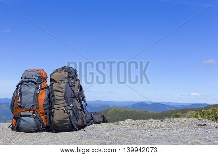 Camping with backpacks in the mountains with views of the mountains