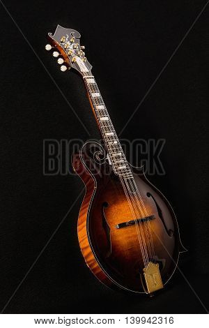 Mandolin isolated on black background, side view